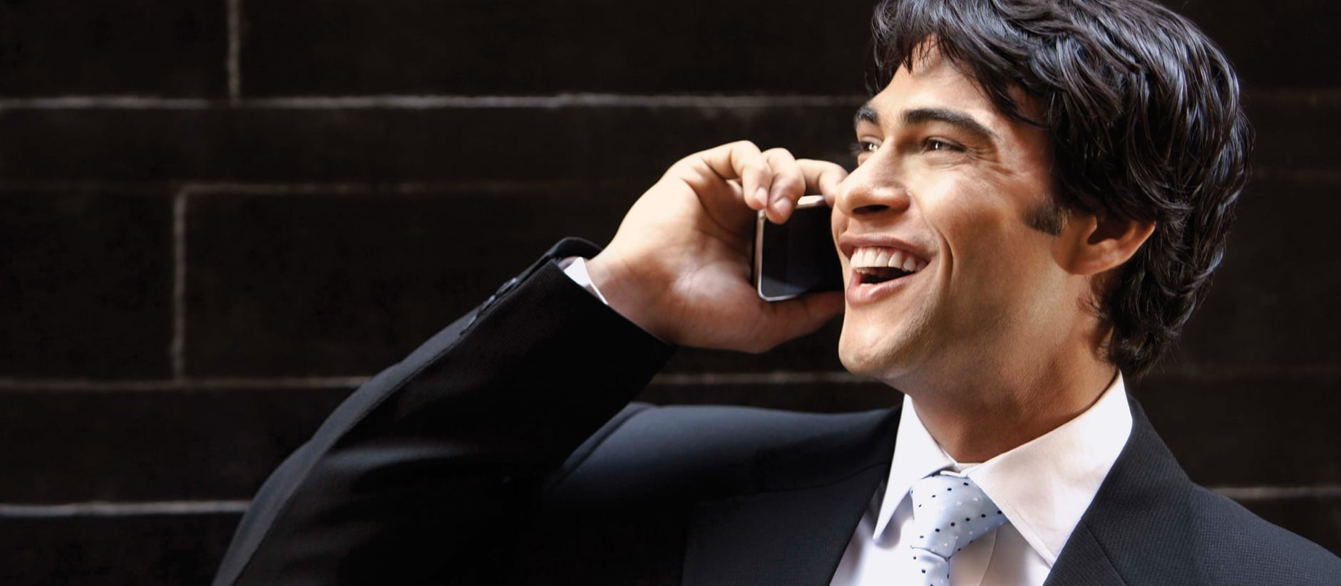 A man smiling while receiving his forwarded call