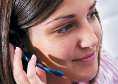 A professional call center lady from A Message Center taking a call